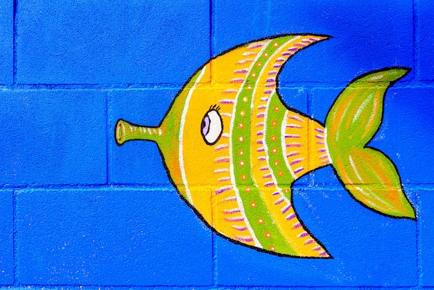 Blue wall with cartoon fish painted