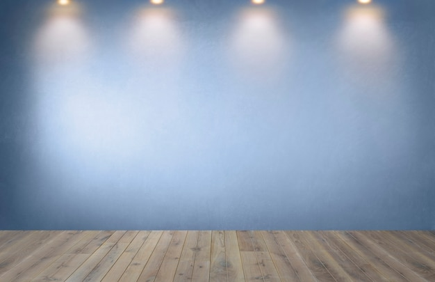 Blue wall with a row of spotlights in an empty room