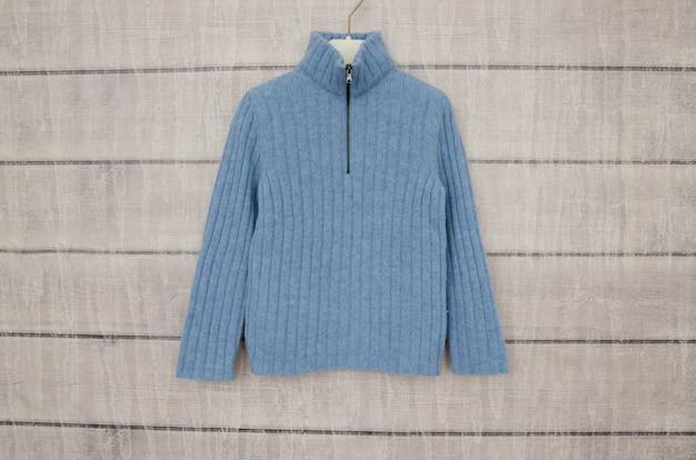Blue warm jacket hanging on a hanger