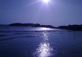 Blue water and sun
