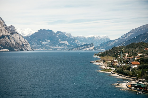 Blue water at the beaches of verona and gorgeous mountains