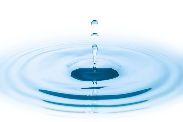 Blue water drop falling down and circles wave