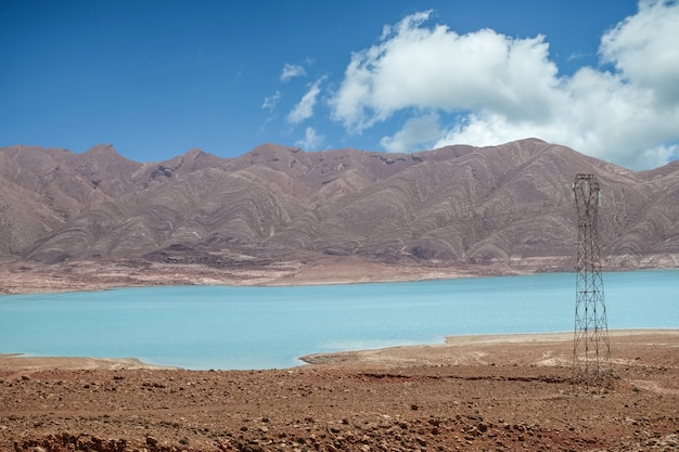 Blue water of a lake against mountain and sky in rural morocco