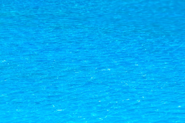 Blue water rippled background in swimming pool