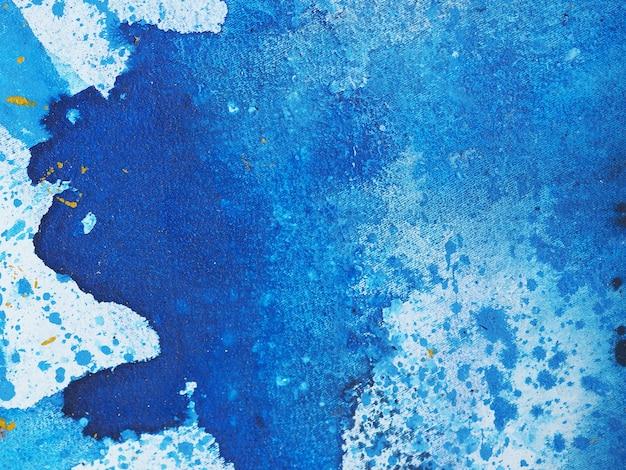 青い水彩画の抽象的なテクスチャ。