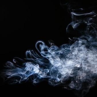 Blue wavy smoke on black background