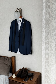 Blue wedding attire for a groom hanging on the wall