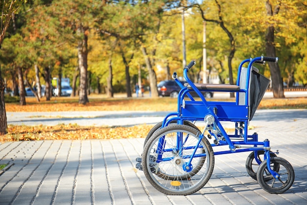 Blue wheelchair outdoors on sunny day