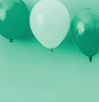 Blue and white balloons on blue background