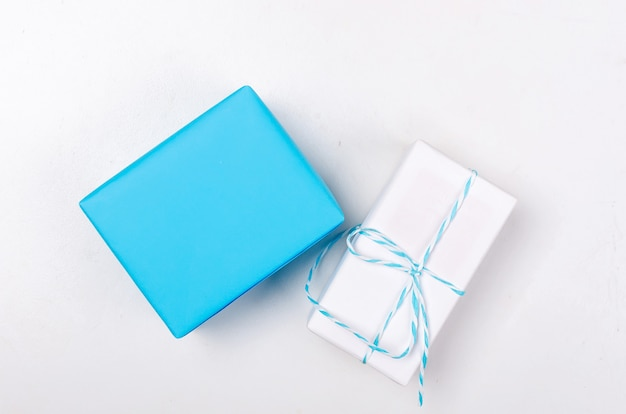 Blue and white gift boxes with ribbon