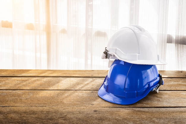 Blue, white hard safety helmet construction hat for safety project of workman