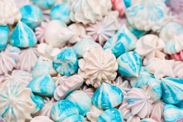 Blue and white meringue. selective focus. top view