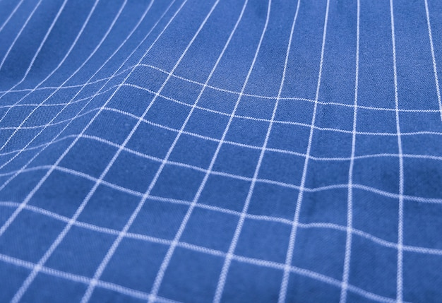 Blue and white plaid fabric background
