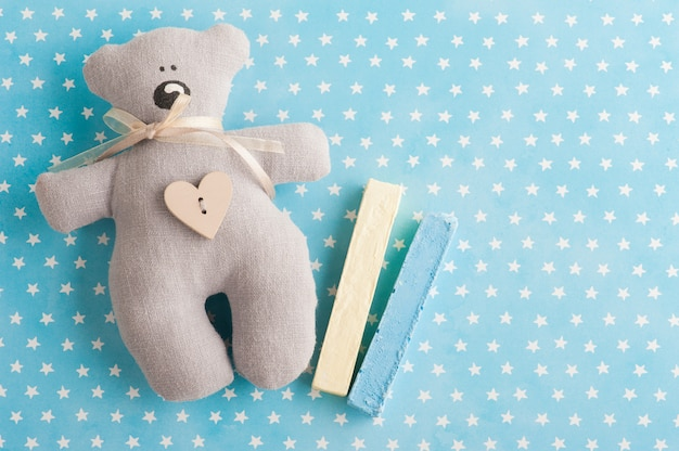 Blue white stars background with teddy bear