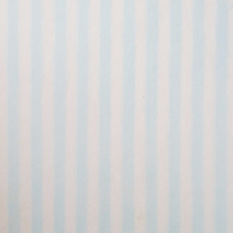 Blue and white striped pattern on mulberry paper textured background, detail close-up