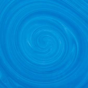 Blue and white swirl color mix fluid art backdrop