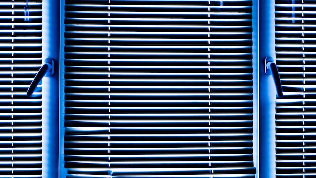 Blue window blinds on a cold winter day