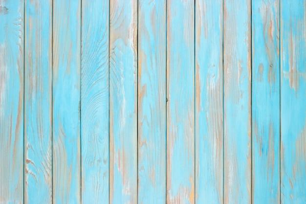 青い木の板、台所のテーブルのぼろぼろの木の表面