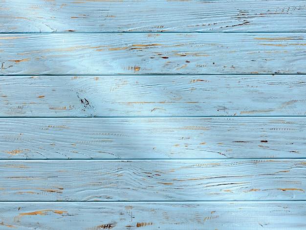 빛의 광선이 있는 푸른 나무 테이블 상판