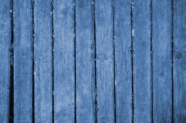 The blue wood texture with natural patterns. classic blue color. color of the year 2020. trendy color.