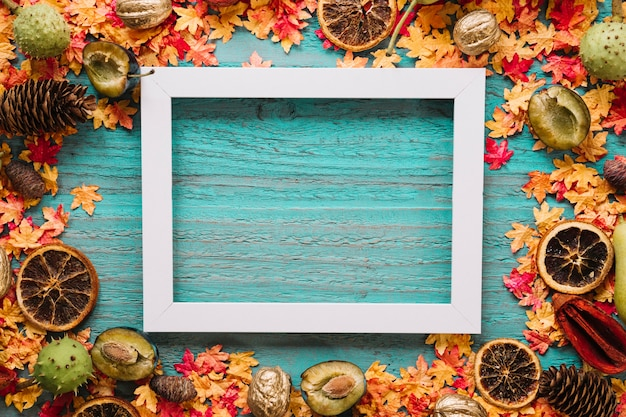Blue wooden background with leaves, harvest and frame picture