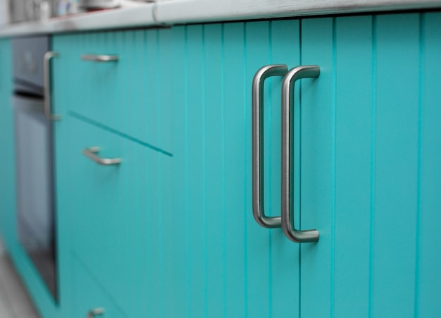 Blue wooden facade of kitchen cabinets .