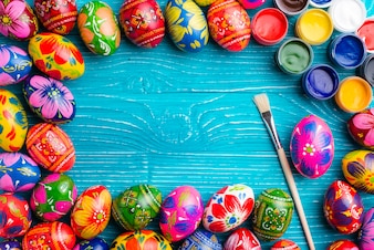Blue wooden surface with frame made of easter eggs