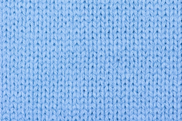 Blue wool knitted background.