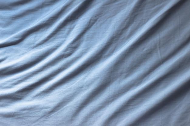 Синяя морщинистая текстура ткани для фона