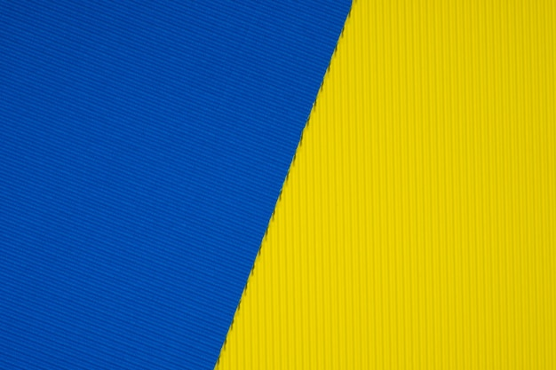 Blue and yellow corrugated paper texture background.