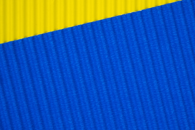 Blue and yellow corrugated paper texture, use for background. vivid colour with empty space for add text or object.