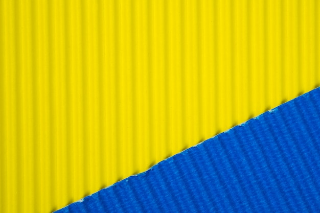 Blue and yellow corrugated paper texture