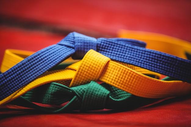 Blue, yellow and green karate belt