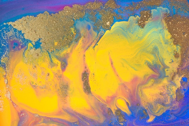 Blue and yellow marble paint with golden glitter. artwork abstract texture.