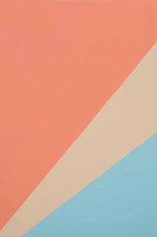파란색, 노란색, 주황색 배경, 색종이는 기하학적으로 영역으로 나눕니다.