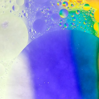 Blue and yellow textured background with bubbles