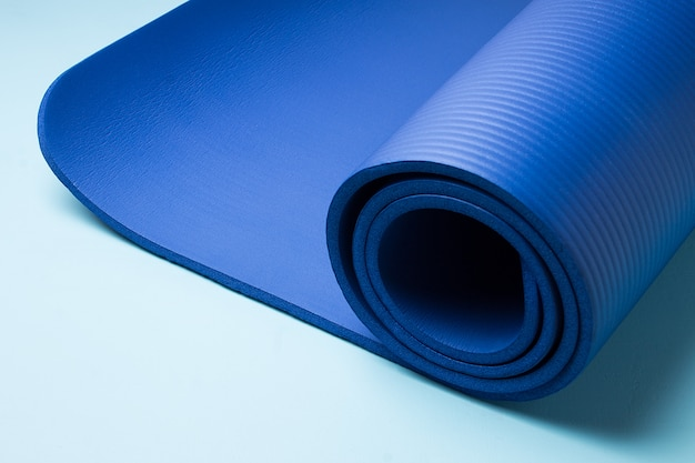 Blue yoga mat . equipment for yoga. concept healthy lifestyle and sport.