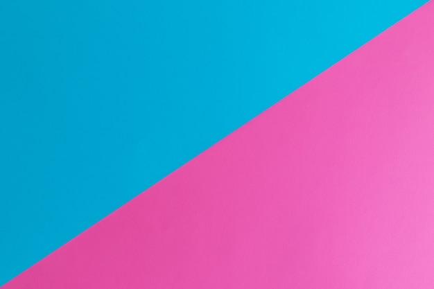 テキスト用のスペースがある青とピンクのパステルカラーの紙の表面