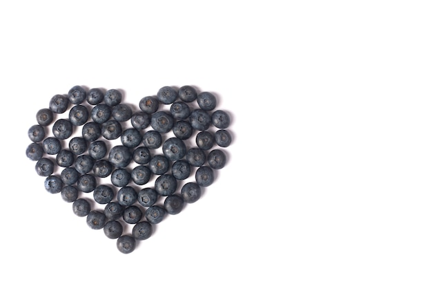 Blueberries laid out in the form of a heart isolated on white background