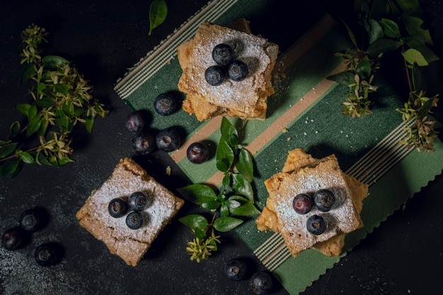 Blueberries pieces of pie with flowers