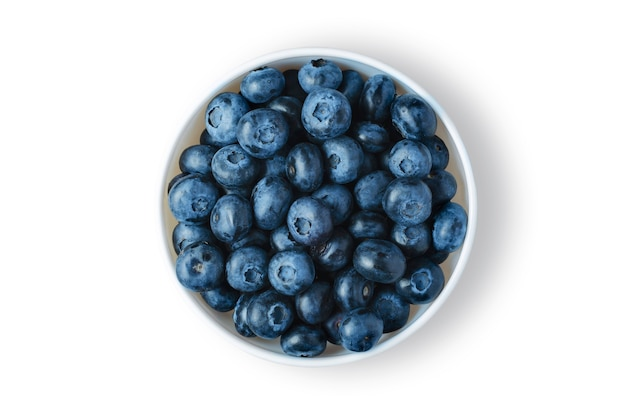 Blueberries. ripe berries in a white plate. isolated on white.