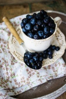 Blueberries on white spoon