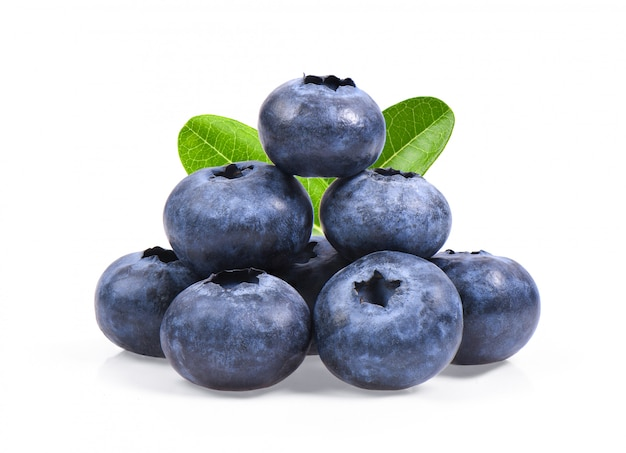 Blueberries with green leaves closeup, isolated on white space