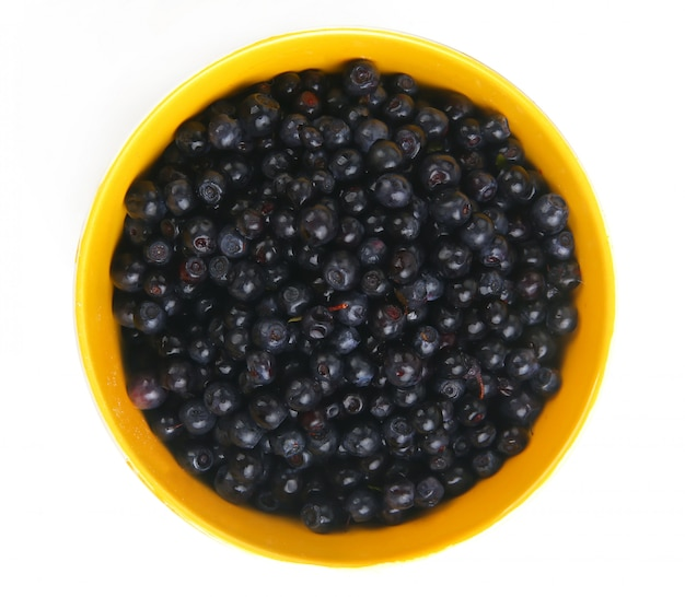 Blueberries with leaf in bowl, cup, plate