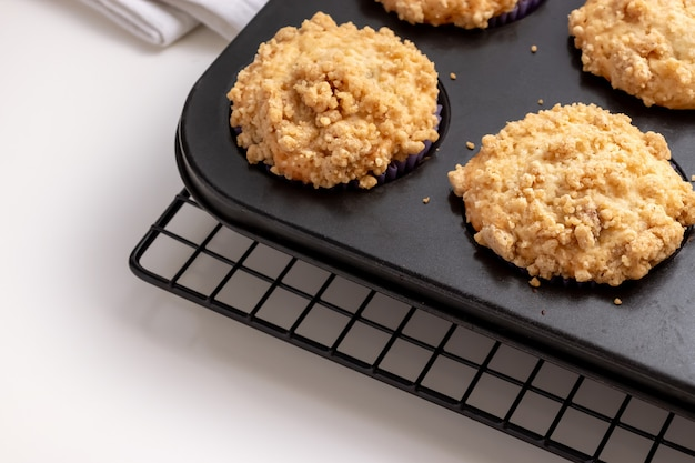 Blueberry apple oats streusel muffins on cooling rack.