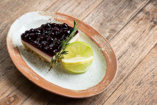Blueberry cheesecake dessert bakery jam piece in plate