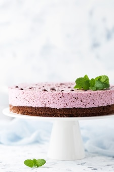 Blueberry cheesecake on a white cake stand