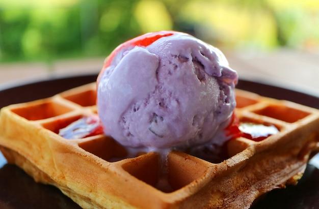 Blueberry ice cream with topped on fresh baked waffle