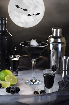 Blueberry martini is a full moon tini in a glass. halloween cocktail idea