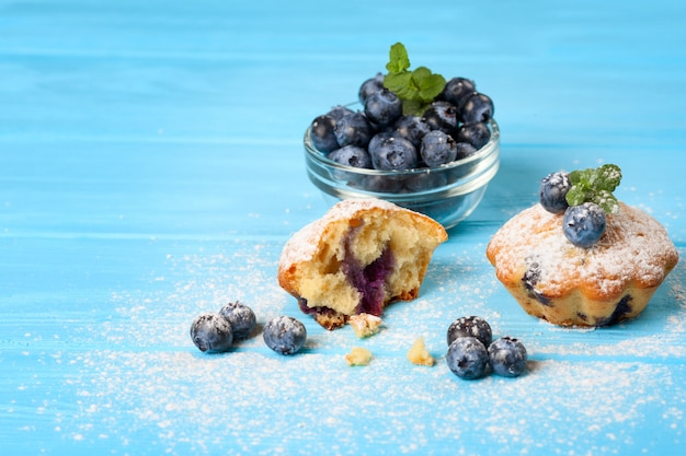 Blueberry muffin. homemade baked cupcake with blueberries, fresh berries, mint